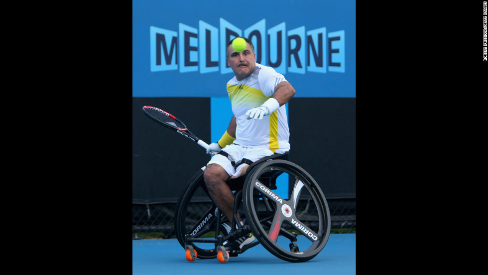 Stephane Houdet of France plays a forehand in his men's wheelchair singles final match on January 26 against Shingo Kunieda of Japan. Kunieda won 6-2 6-0.
