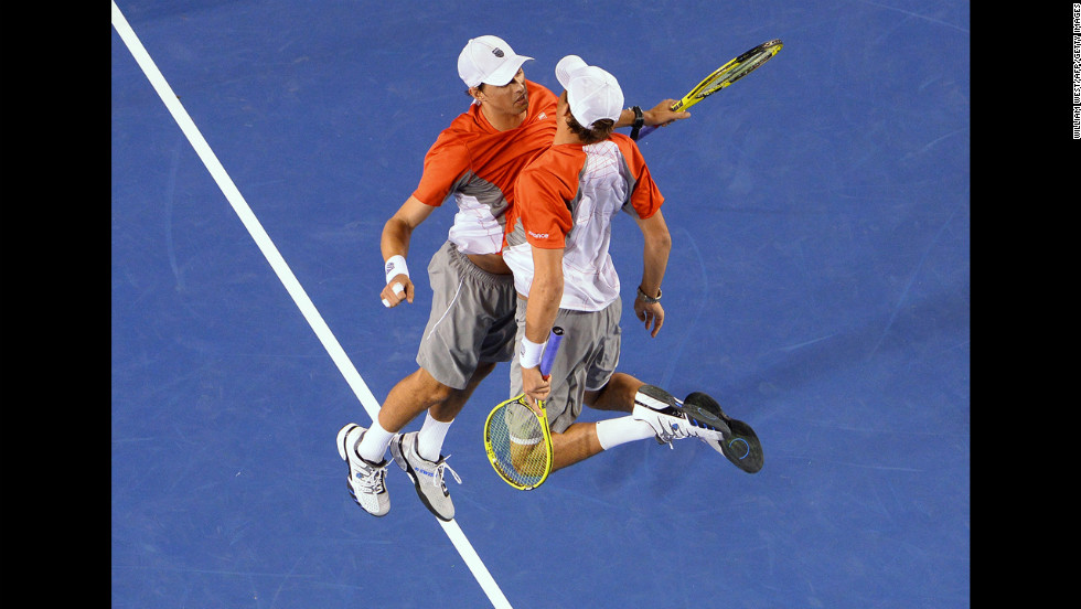 Mike Bryan, left, and his brother, Bob Bryan, of the U.S. celebrate after their victory over the Netherlands' Robin Haase and Igor Sibling during the men's doubles final January 26.