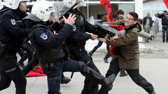 A leftist clashes with Turkish policemen during a January 21 protest in Adana against NATO's installation of Patriot missiles.
