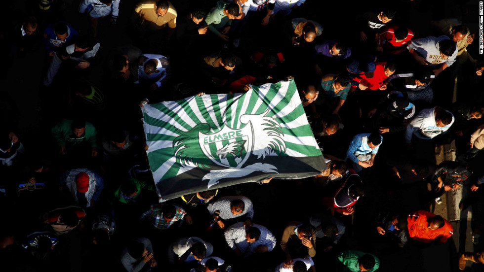Egyptian protesters and fans of Al-Masry football club wave their club colors as they take part in a demonstration in front of the prison in the Egyptian Suez Canal city of Port Said on Friday, January 25, calling for the prisoners who are suspected of killing 74 fans of Al-Ahly club during a football match in February 2012 not to be transferred to Cairo to attend their trial. A judge sentenced 21 people to death for their roles in the riot last year.