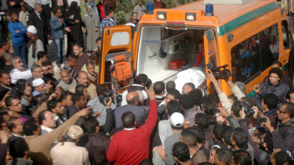 Relatives and friends of Egyptian protesters who were killed in Suez during clashes with riot police Friday, load a body onto an ambulance outside the morgue in Suez on January 26.