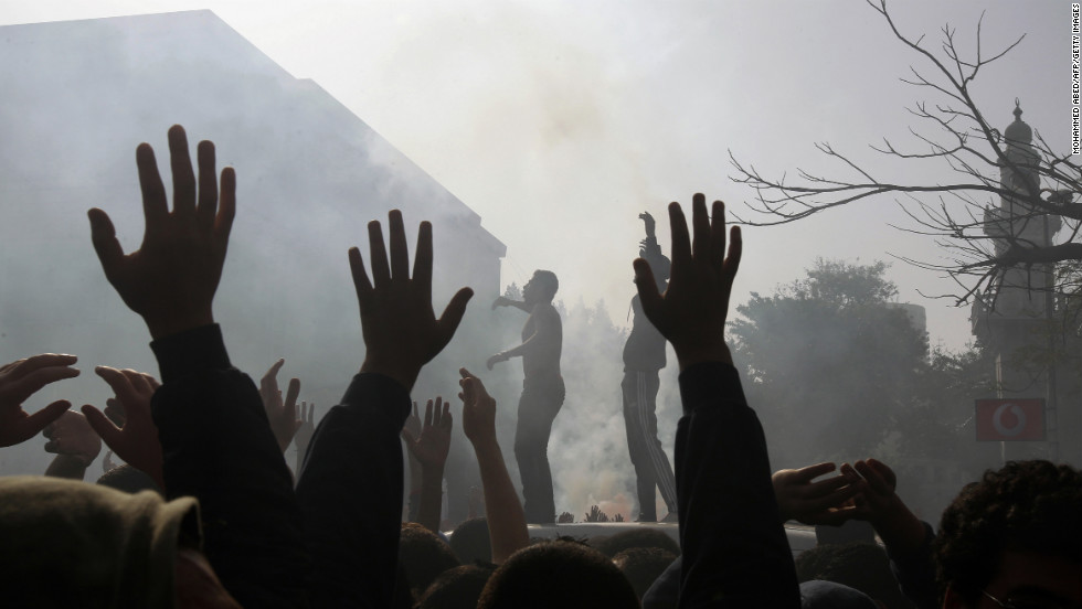 Al-Ahly football club supporters celebrate outside the club's headquarters in Cairo on January 26.