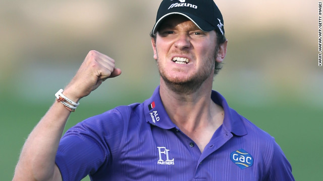 Chris Wood celebrates after holing an eagle putt on the final hole to win the Qatar Masters in Doha on Saturday.