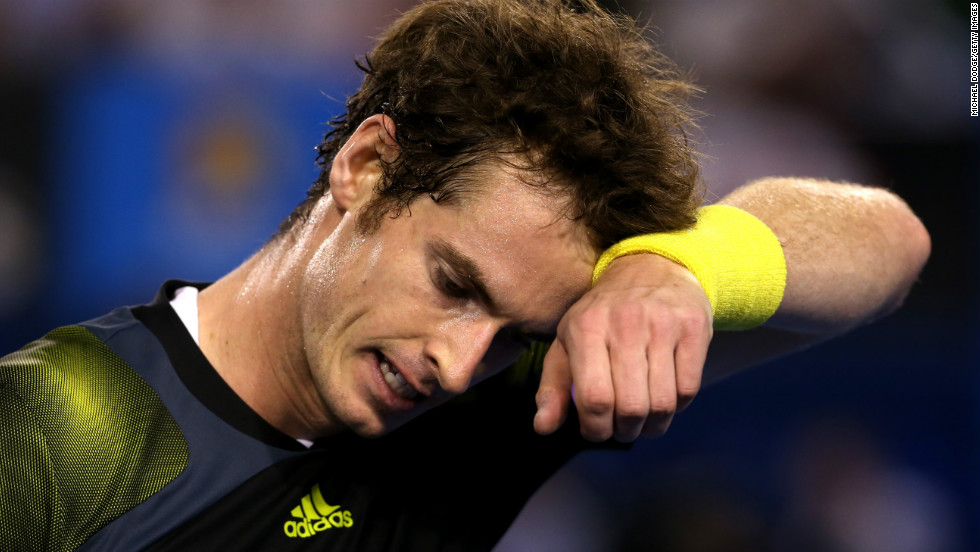 Murray wipes his face during his men's final match against Djokovic on January 27.