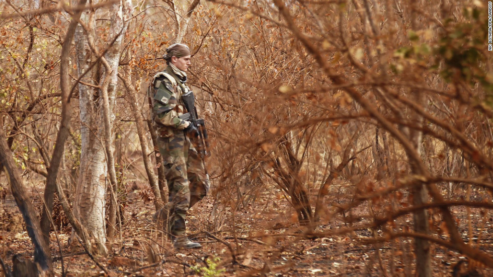 A French soldier walks through the bush in central Mali on January 27.