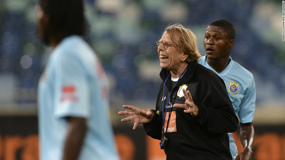Mbemba was recently with the Congolese squad at the Africa Cup of Nations. He is pictured here, standing behind the team's French coach Claude Leroy, in a training session. Mbemba was not used by Leroy in the tournament.