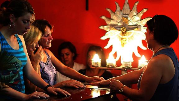 Relatives pray at the wake of a victim on January 27 in Santa Maria.