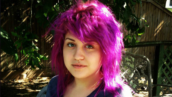 For Emily, a straight A- and B-student with a penchant for dying her hair bright colors, school has never really been a problem, says her stepfather, Tommy Bryant. This family photo was taken in March 2012.