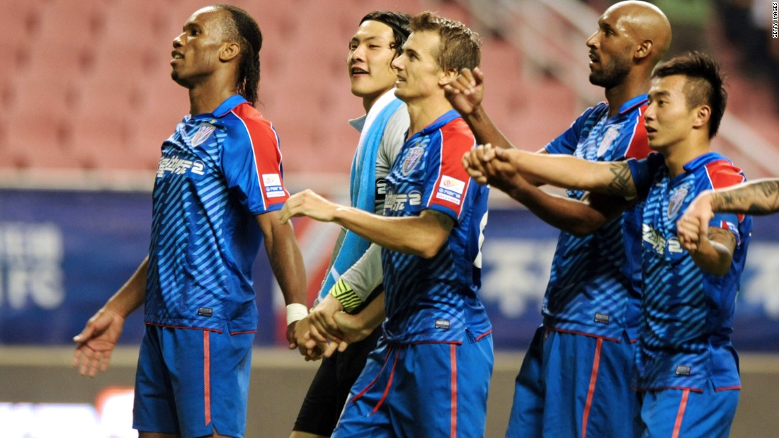 Didier Drogba (far left) and Nicolas Anelka (second from right) attending a training session in Shanghai. Their spells in China didn't last long though and the pair exited in 2013.