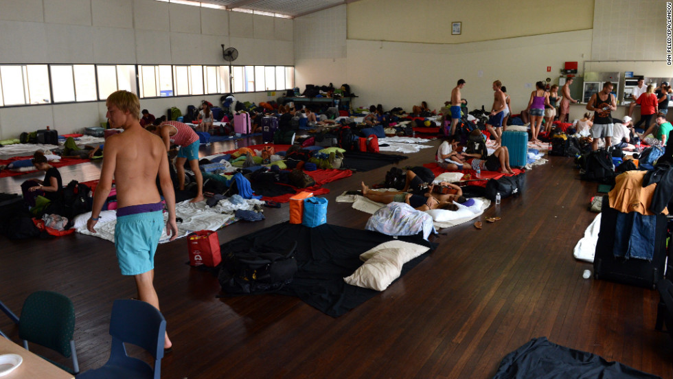 Tourists and local residents take shelter at an evacuation center in Bundaberg, Queensland, on January 28. Thousands of people have been evacuated from their homes.
