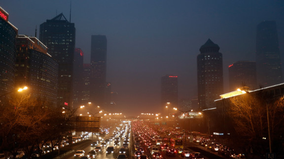 Cars travel through the smog on Wednesday, January 23, when the pollution hit serious levels.
