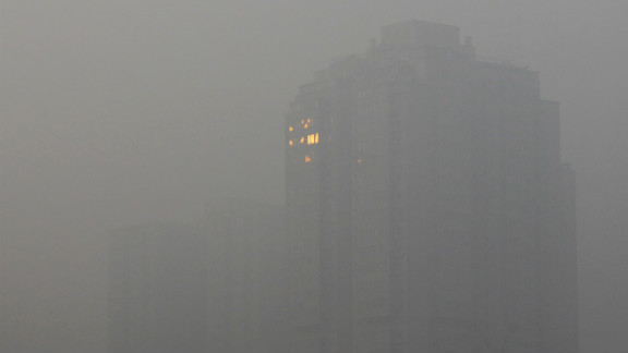 The sunlight reflects off a building in Beijing on Saturday, January 12.