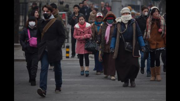 Pedestrians cross a street on January 13.