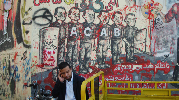 "The Ahlawy played a crucial role in Egypt's two-year-old revolution. Graffiti honoring them and the dead can be seen throughout Egypt. This piece of graffiti next to Tahrir Square shows a line of police, each with the former dictator Hosni Mubarak's face. The acronym ACAB stands for ""All Cops Are Bastards."""