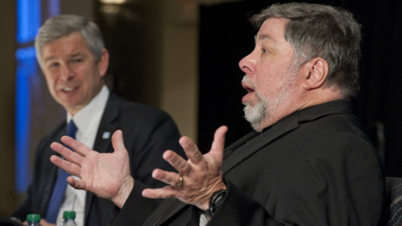 Apple co-founder Steve Wozniak, right, speaks with Georgia State University Mark Becker during Wednesday