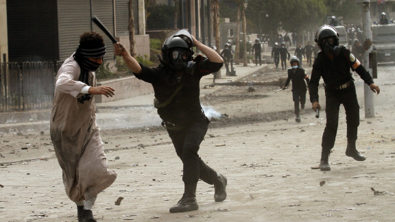 A riot police officer clashes with a protester near Cairo's Tahrir Square on January 28.