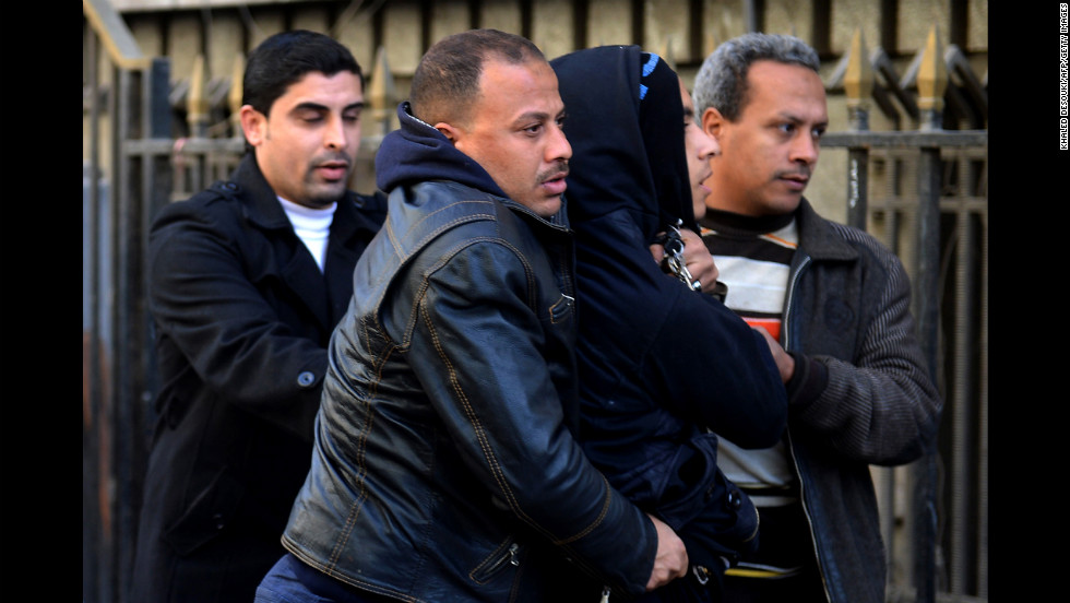 Police in plainclothes detain a youth suspected of being a member of the Black Bloc opposition group during a demonstration on January 30 in Cairo.