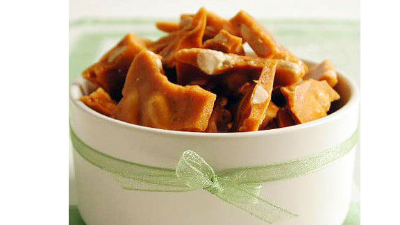 """Pepper adds an unexpected bit of heat to this brittle, but you can omit it for a more traditional version. One serving is 105 calories. <strong>Try this recipe:</strong> <a href=""""http://www.myrecipes.com/recipe/peppered-peanut-brittle-10000000522336/"""" target=""""_blank"""" target=""""_blank"""">Peppered peanut brittle</a>"""