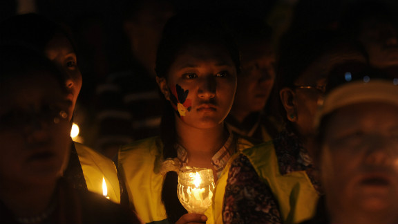 Tibetan Buddhist monks and members of Tibetan Youth congress hold lit candles during a protest in Siliguri, November 28, 2012.