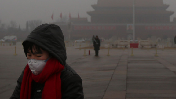 A pedestrian wears a mask at Tiananmen Square as protection from severe pollution on Thursday, January 31, 2013, in Beijing. It's the fourth time this year that a heavy blanket of smog has affected eastern China, including the capital. The air quality has reached hazardous levels, and residents were encouraged to avoid outdoor activities. Watch a video explaining the hazardous smog.