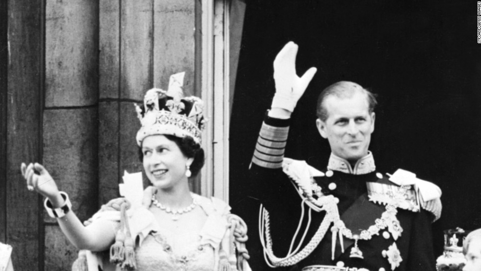 Queen Elizabeth II, with her husband Prince Philip, waves to the crowd on June 2, 1953, after being crowned  at Westminster Abbey in London.