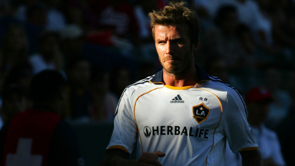 Beckham, during his time with the Los Angeles Galaxy, walks toward the line judge to have a chat during Game 1 of the MLS Western Conference semifinals in 2009.