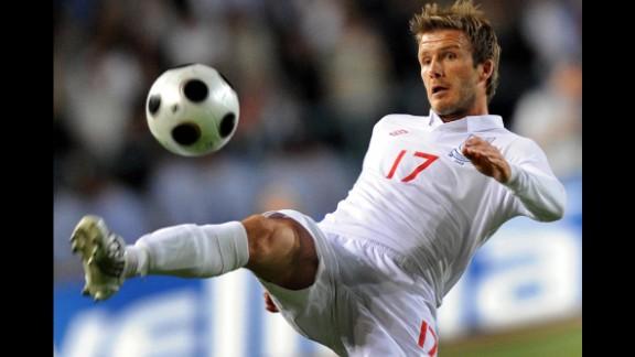 Beckham controls the ball during a 2010 World Cup qualifier.