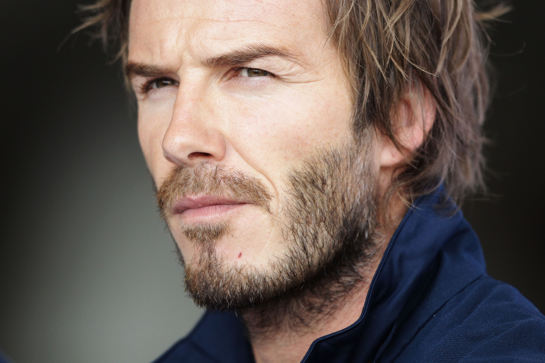 David Beckham Enters Hotel Game CNN Travel - David beckham armani hairstyle