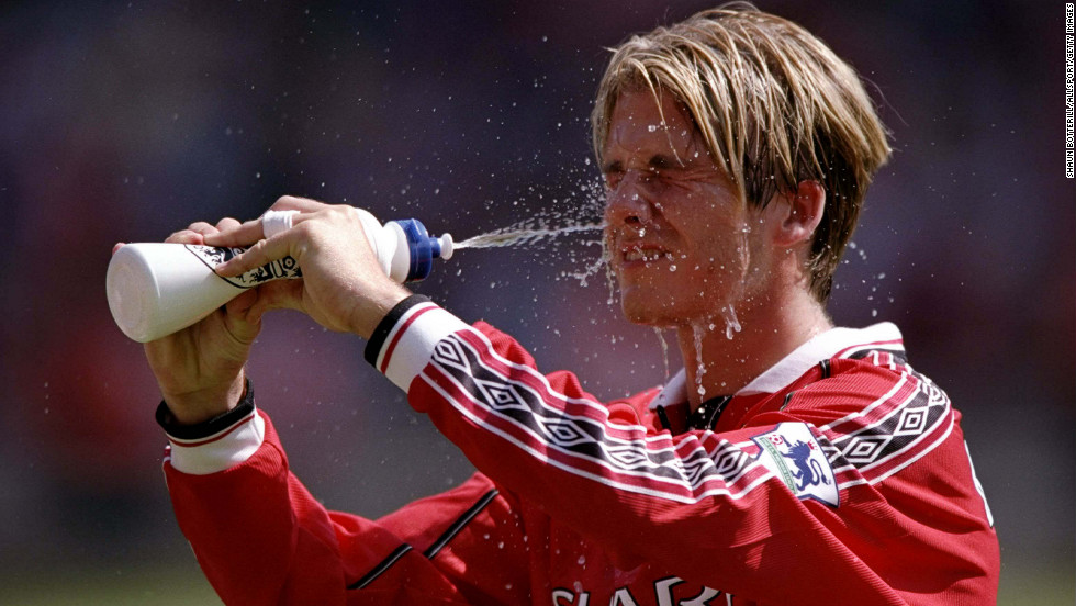 As a player on Manchester United, Beckham cools down during the FA Charity Shield match against Arsenal in 1998.