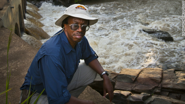 Dr. Moses Katabarwa inspects a fast moving stream of the type where the black flies breed.