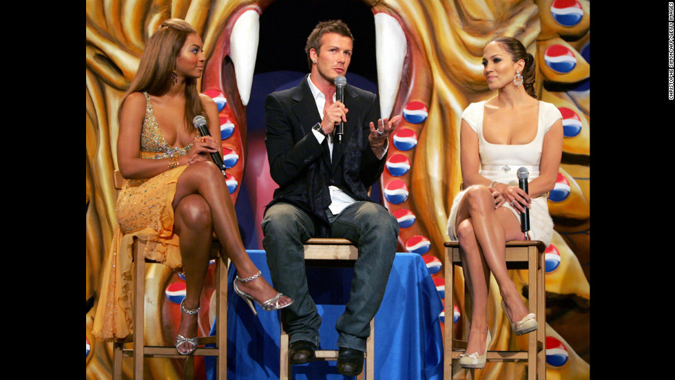 "Beckham poses with Beyonce, left, and Jennifer Lopez in Madrid during a presentation of the new Pepsi ""Samourai"" in 2004."