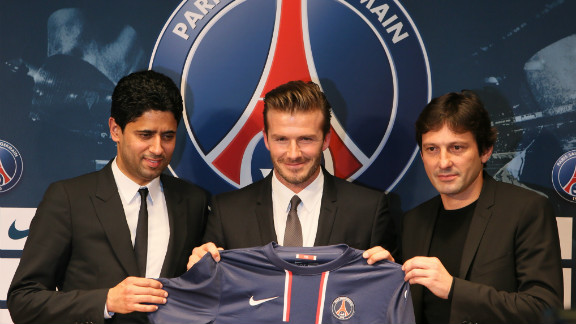 Beckham poses with Paris Saint-Germain President Nasser Al-Khelaifi, left, and PSG sports director Leonardo during a news conference announcing his new gig in January 2013.