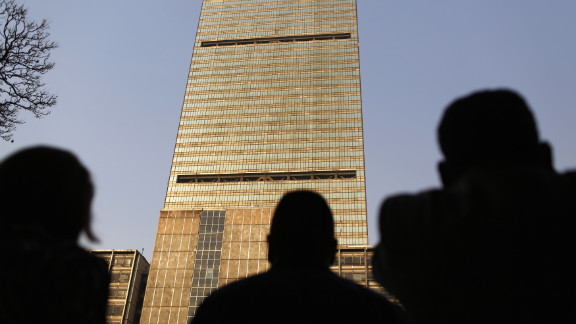 Onlookers look up at the headquarters of the Pemex building in Mexico City.
