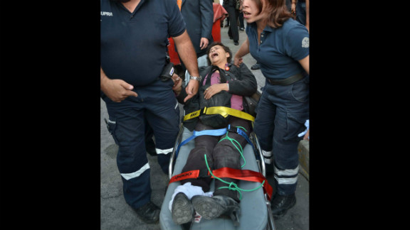 A woman receives medical attention on a stretcher after the explosion.