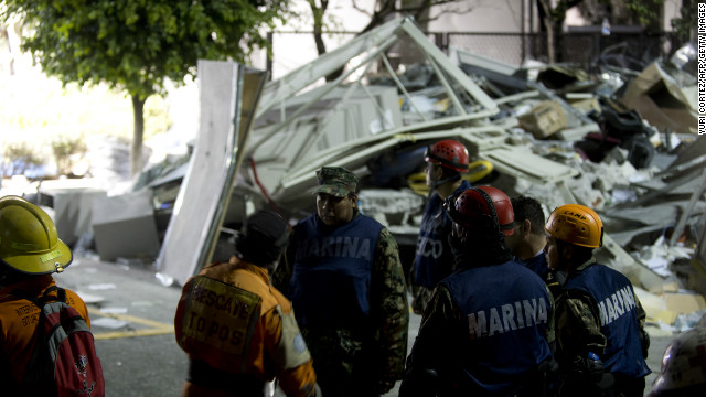 Rescue workers search for victims at the Pemex headquarters in Mexico City on Thursday.