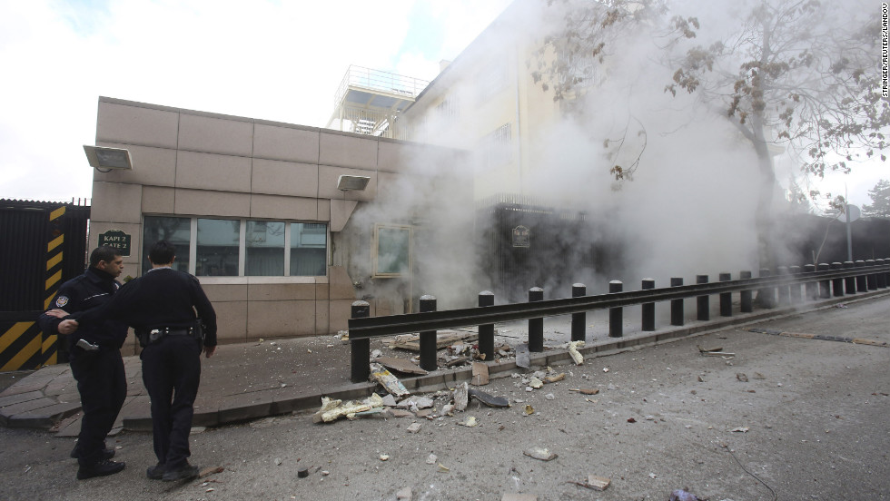 Turkish police officers react after an explosion at the entrance of the U.S. Embassy in Ankara Friday, February 1, in this picture provided by Milliyet Daily Newspaper.