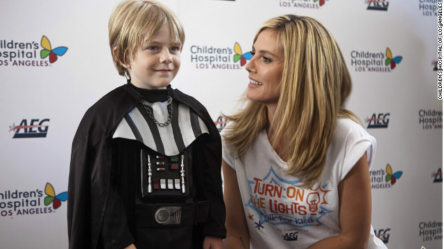 The actor appears with Heidi Klum before a charity event.