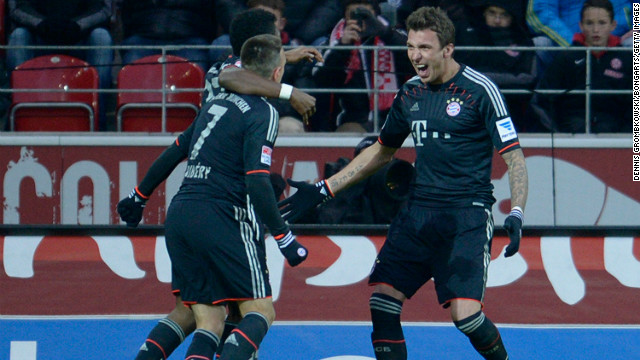 Mario Mandzukic (right) celebrates with his Bayern Munich teammates during the 3-0 against Mainz