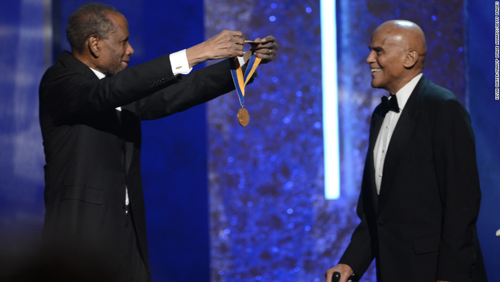 Harry Belafonte was presented with the NAACP's highest honor, the Spingarn Medal, by long-time friend Sidney Poitier.