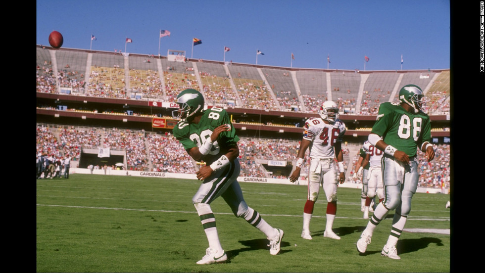 Wide receiver Cris Carter of the Philadelphia Eagles celebrate a touchdown by spiking the ball in the end zone during a game against the Phoenix Cardinals at Sun Devil Stadium in Tempe, Arizona. Carter is also a Hall of Fame selection.