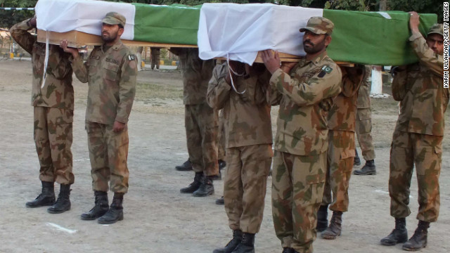 Pakistani soldiers carry the coffins of comrades killed in a suicide attack at a funeral in Sari Norang, February 2, 2013.