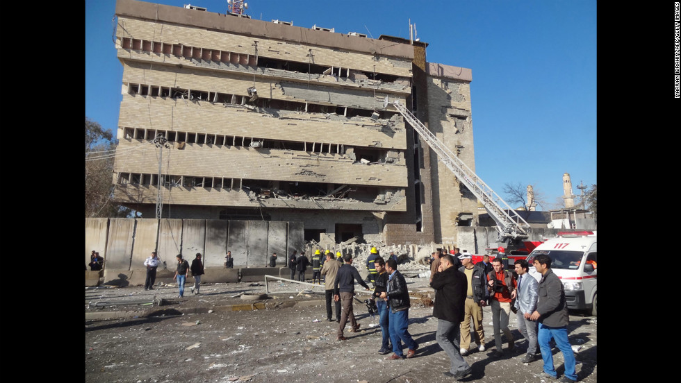 Iraqi rescuers and firefighters work at the scene on February 3.