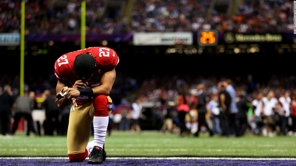 C.J. Spillman of the San Francisco 49ers kneels in the endzone prior to the start of Super Bowl XLVII against the Baltimore Ravens.