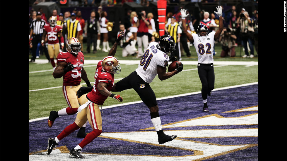 Ravens wide receiver Anquan Boldin brings the ball down in the end zone.