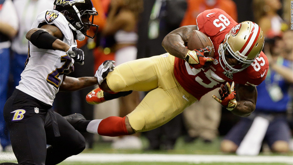 Vernon Davis of the San Francisco 49ers goes airborne after catching a pass  against the Baltimore 3a2fe9b21