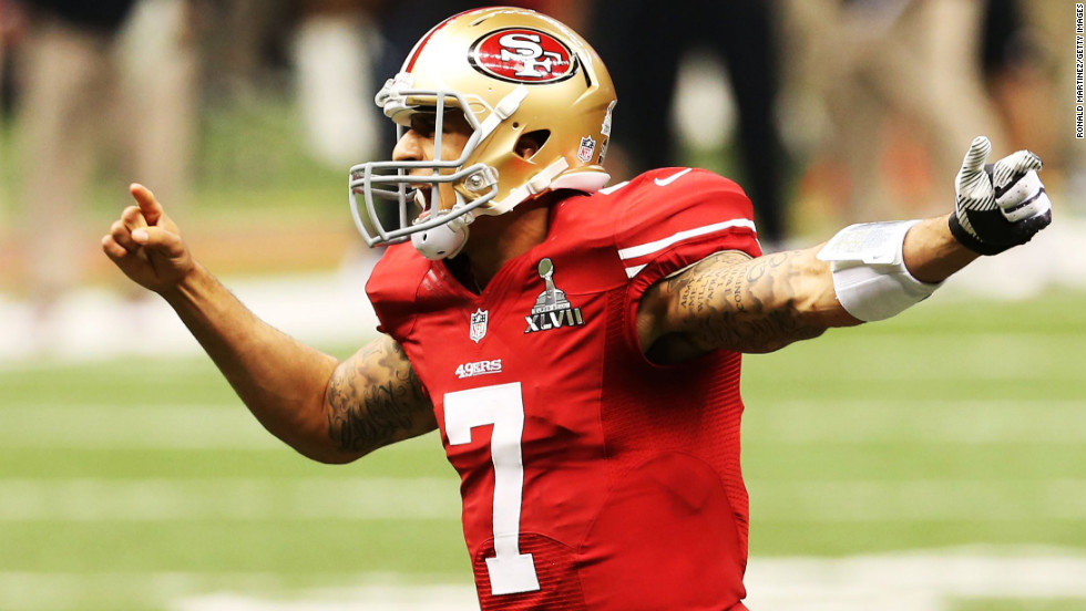 49ers quarterback Colin Kaepernick directs his teammates before a snap in the first quarter.