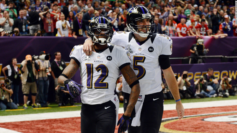 Jacoby Jones, left, and Joe Flacco of the Baltimore Ravens celebrate after their second-quarter touchdown.