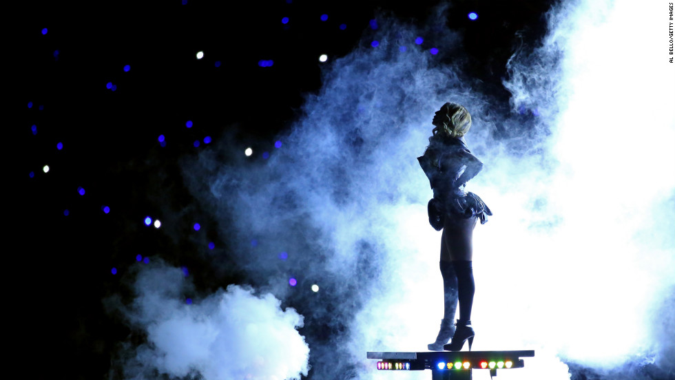 Beyonce appears on a rising platform during the halftime show.