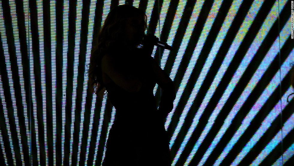 Beyonce was also silhouetted as she performed