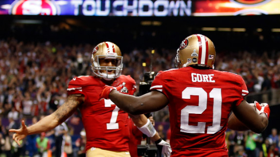 Running back Frank Gore of the San Francisco 49ers celebrates with quarterback Colin Kaepernick after scoring a touchdown in the third quarter.